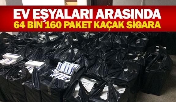 Ev eşyaları arasında 64bin 160 paket kaçak sigara
