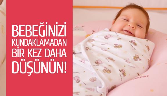 Bebeğinizi kundaklamadan bir kez daha düşünün!