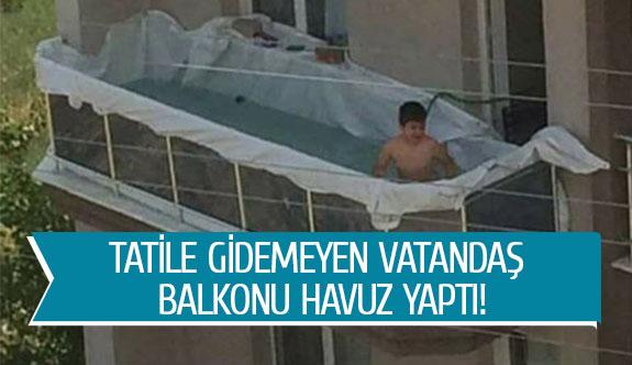 Tatile gidemeyen vatandaş balkonu havuz yaptı!
