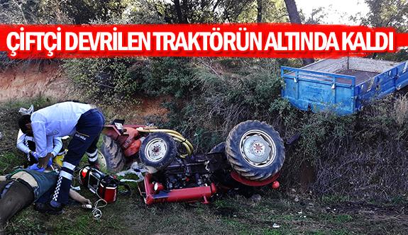 Çiftçi devrilen traktörün altında kaldı