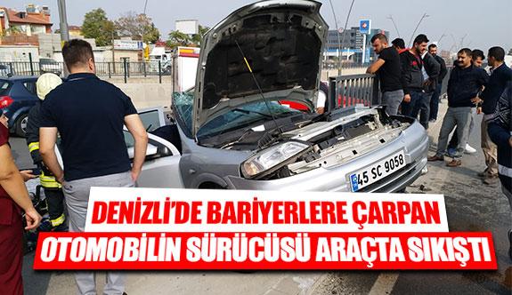 Denizli'de bariyerlere çarpan otomobilin sürücüsü araçta sıkıştı