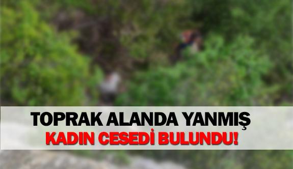 Toprak alanda yanmış kadın cesedi bulundu!