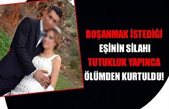 Boşanmak istediği eşinin silahı tutukluk yapınca ölümden kurtuldu!