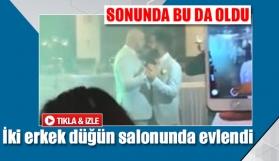 İki erkek düğün salonunda evlendi