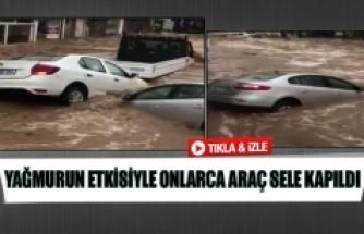 Yağmurun etkisiyle onlarca araç sele kapıldı