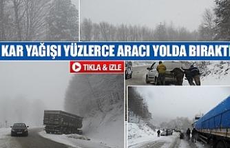Kar yağışı yüzlerce aracı yolda bıraktı