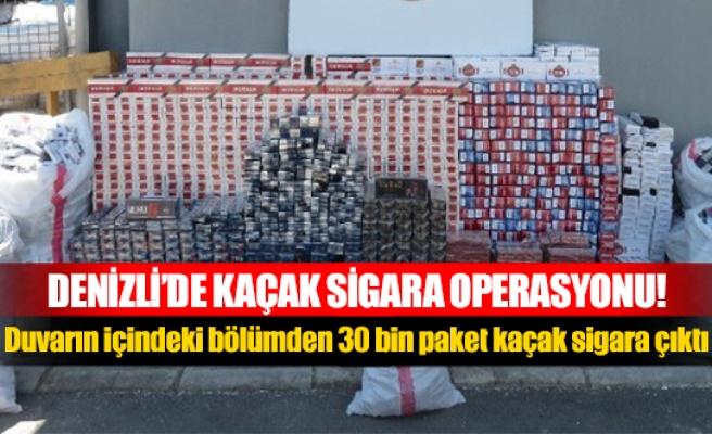Duvarın içindeki bölümden 30 bin paket kaçak sigara çıktı