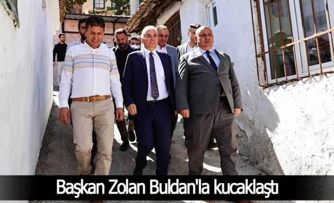 Başkan Zolan Buldan'la kucaklaştı